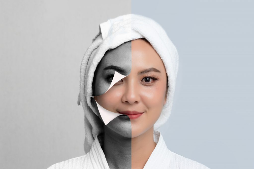 Asian woman wearing spa robe and towel on head. Dermaplaning benefits, side effects, and kits to perform dermaplaning at home. #skincare #skincareproducts #skincarereview #dryskin #acneprone #oilyskin
